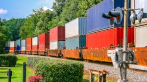 Colorful Freight Train across railroad crossing in Norcross, Georgia
